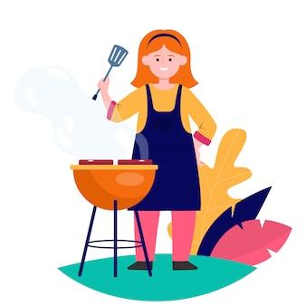 Glückliche frau, die grillfleisch grillt