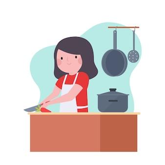 Glückliche frau, die in der küche kocht