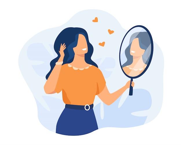 Glückliche frau, die sich im spiegel betrachtet