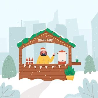 Glückliche frau im weihnachtsmarktstand, der glühwein im stadtwinterferienkonzept verkauft