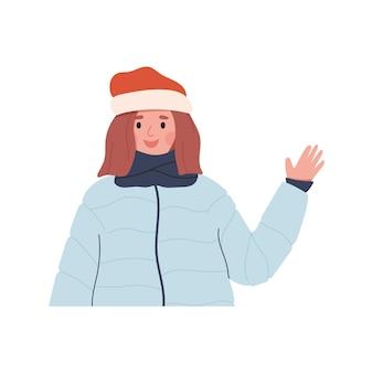 Glückliche frau im winterhutschal und daunenpufferjacke, die hand lächelt und winkt