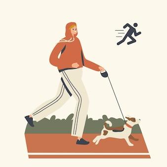 Glückliche frau in sportbekleidung und turnschuhen, die mit hund entlang der stadionspur oder des parks läuft