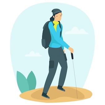 Glückliche frau klettert allein im frühjahr auf einen berg