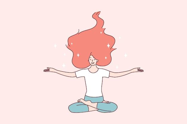 Glückliche frau mit den roten haaren, die auf boden mit offenen armen in lotussitz sitzen