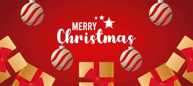 Glückliche frohe weihnachten-beschriftungskarte mit goldenen geschenken und hängenden illustrationen der kugeln