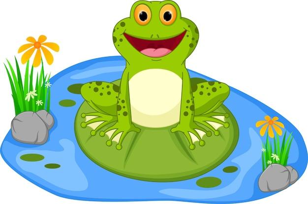 Glückliche froschkarikatur, die auf einem blatt sitzt