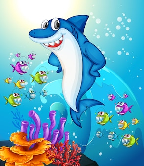 Glückliche hai-zeichentrickfigur in der unterwasserszene mit vielen exotischen fischen