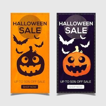 Glückliche halloween-fahne mit kürbisen und schlägern