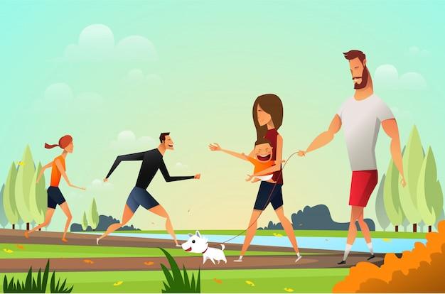 Glückliche junge familie mit einem kleinen hund im park