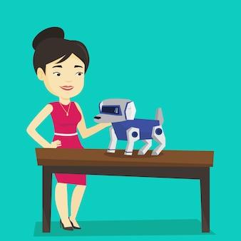 Glückliche junge frau, die mit roboterhund spielt.