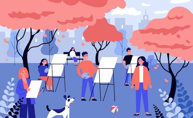 Glückliche junge künstler, die natur unter freiem himmel malen