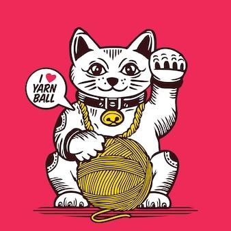 Glückliche katze mit wollknäuel maneki neko