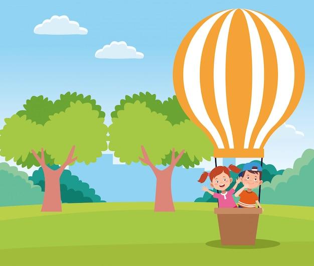 Glückliche kinder der karikatur in einem heißluftballon auf dem gebiet