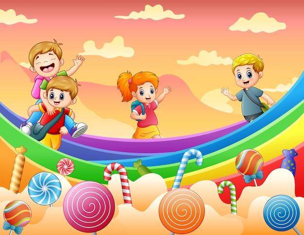 Glückliche kinder, die auf einer süßigkeitenlandillustration spielen