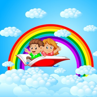Glückliche kinder, die auf großes offenes buch fliegen