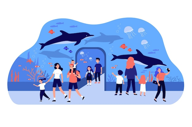 Glückliche kinder, die im ozeanarium gehen