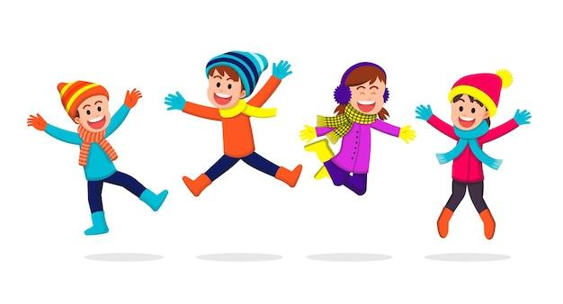 Glückliche kinder, die winterkleidung tragen und zusammen springen