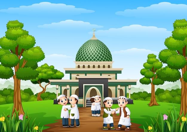 Glückliche kinderkarikatur feiern eid mubarak im park mit moschee