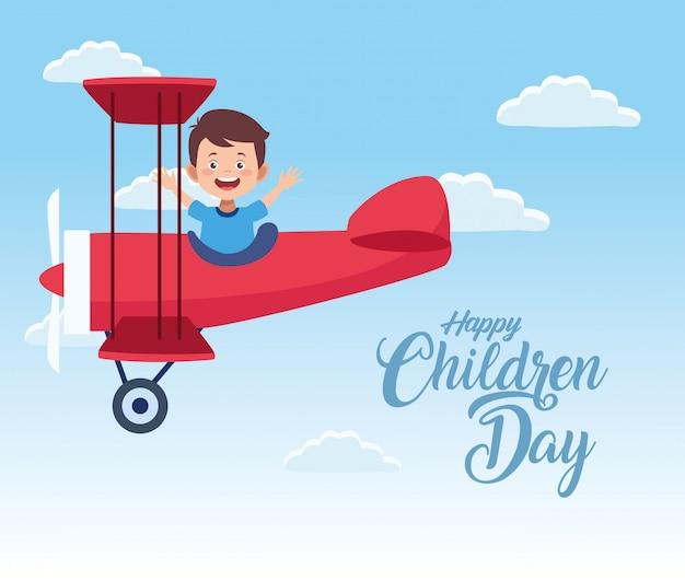 Glückliche kindertagesfeier mit jungenfliegen im flugzeug