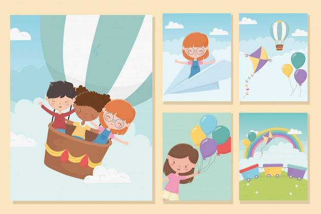 Glückliche kindertagesmädchen und lustige feierfahnen der jungen
