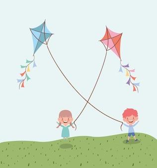 Glückliche kleinkinder, die drachen auf dem gebiet fliegen, gestalten landschaftlich