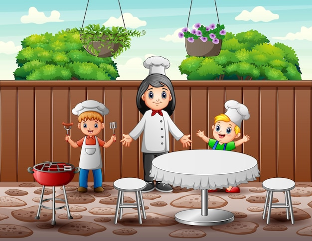 Glückliche köchin und kinder im restaurant
