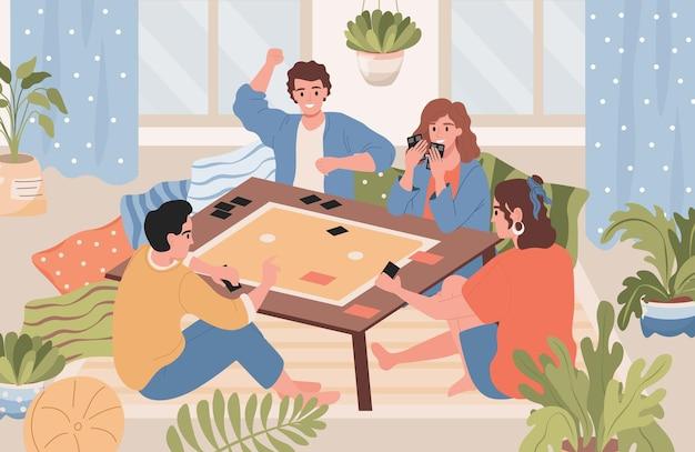 Glückliche lächelnde freunde, die wochenende zusammen tischspiel spielen