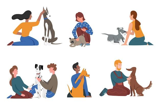 Glückliche leute mit haustierhundefreunden setzen jungen mannfrauencharakter, der hündchen umarmend sitzt
