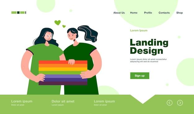 Glückliche mädchen, die die landingpage im flachen stil mit der regenbogenflagge zusammenhalten