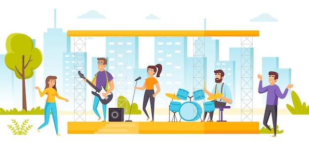 Glückliche menschen, die musik beim open-air-konzert genießen