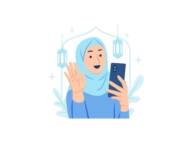 Glückliche muslimische hijab-frau zu hause, die smartphone verwendet und ihre freunde oder familie während des videoanrufs auf ramadan begrüßt