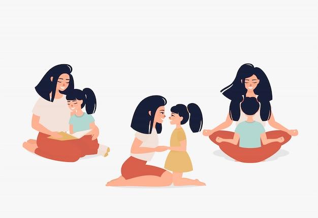 Glückliche mutter mit einer tochter, die spricht, das yoga tut und liest ein buch