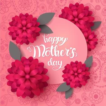 Glückliche muttertag-grußkarte. handgemachte trendige beschriftung mit frühlingsblumen auf rosa paisley-muster.