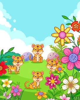 Glückliche nette tiger mit den blumen, die im garten spielen
