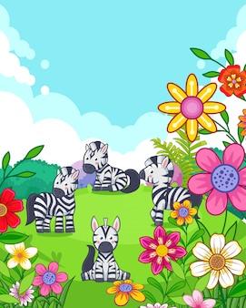 Glückliche nette zebras mit den blumen, die im garten spielen