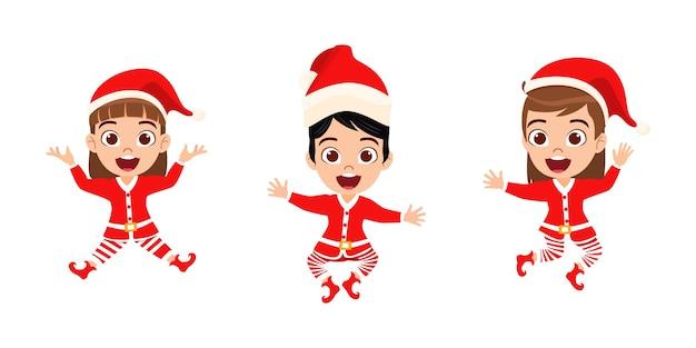 Glückliche niedliche kindermädchen springen und winken und feiern fröhliche charismas lokalisiert auf weißem hintergrund