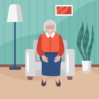Glückliche oma sitzt im sessel in ihrem haus seniora-frau im cartoon-stil im wohnzimmer