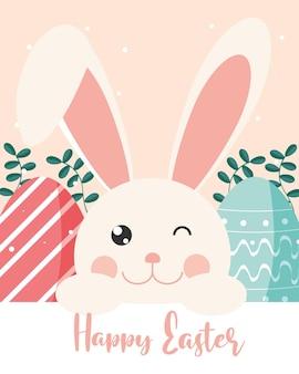 Glückliche ostergrußkarte mit niedlichem kaninchen, ostereiern und blumendekoration