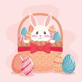 Glückliche ostersaisonkarte mit kaninchen und eiern gemalt in korbillustration