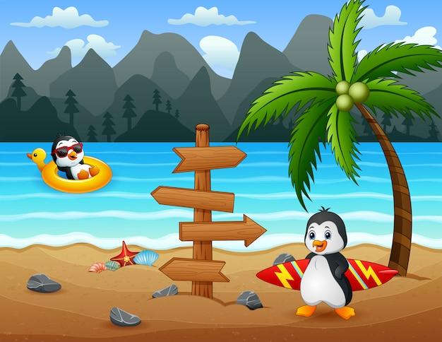 Glückliche pinguine am tropischen strand