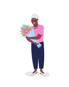 Glückliche reife afroamerikanerfrau mit blumen flach. oma mit blumenstrauß.