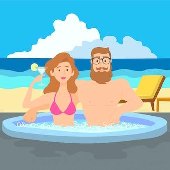 Glückliche romantische paare, die ein bad im jacuzzi genießen