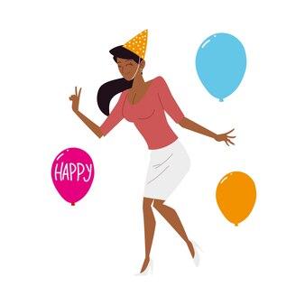 Glückliche schöne frau mit partyhut und ballonfeier
