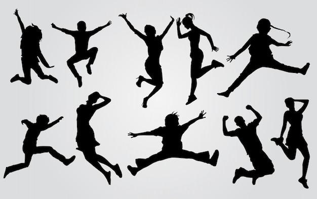 Glückliche springende leute-silhouetten. schattenbildgruppe der leute, die auf weißem hintergrund springen. glückliches feierkonzept.