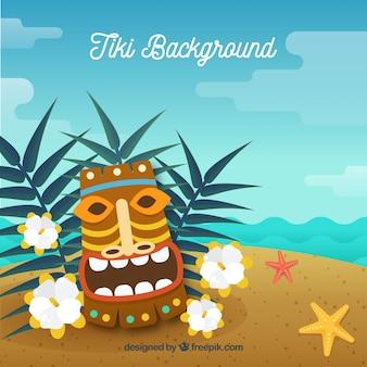 Glückliche tiki maske mit pflanzen am strand