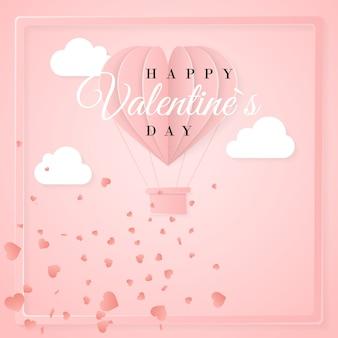 Glückliche valentinstag-einladungskartenschablone mit heißluftballon des origami-papiers in herzform, weißen wolken und konfetti. rosa hintergrund.