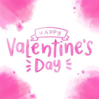 Glückliche valentinstagbeschriftung mit rosa aquarellflecken