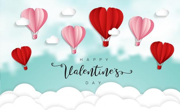 Glückliche valentinstagstypographie mit papier schnitt das heißluftballonfliegen der roten herzform
