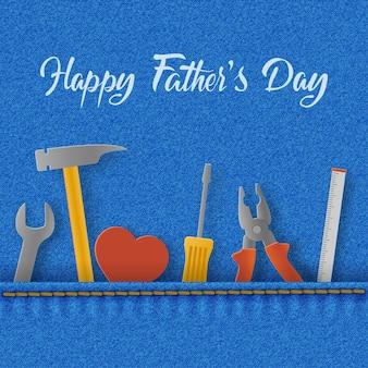 Glückliche vatertagskarte mit herz und werkzeugen in der denimtasche, schraubenschlüssel, hammer und schraubendreher.