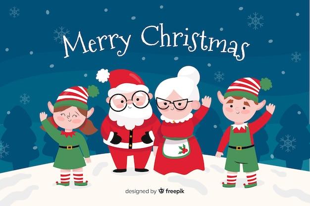 Glückliche weihnachtsmann-familie draußen